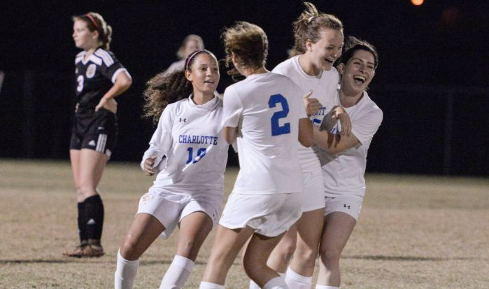 The Charlotte girls soccer team congratulates their teammate, Sydney Kruger, after she scores against Palmetto (Sun Photo by Jennifer Bruno).
