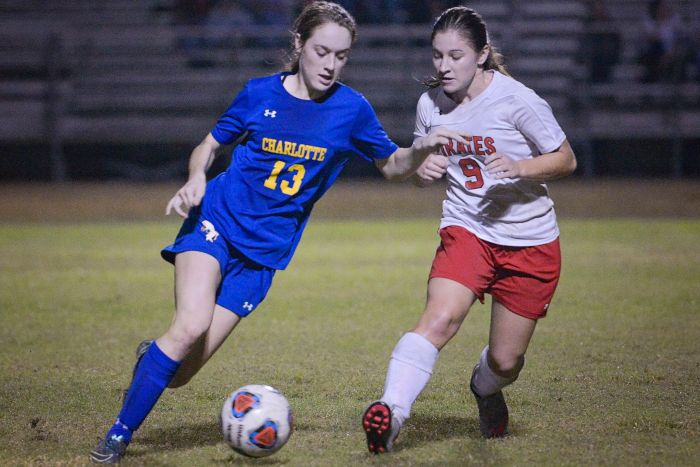 Charlotte's Caitlyn Lowery dribbles the ball down the field as Port Charlotte's Corrine Cresky attempts to gain possession (Sun Photo by Jennifer Bruno).