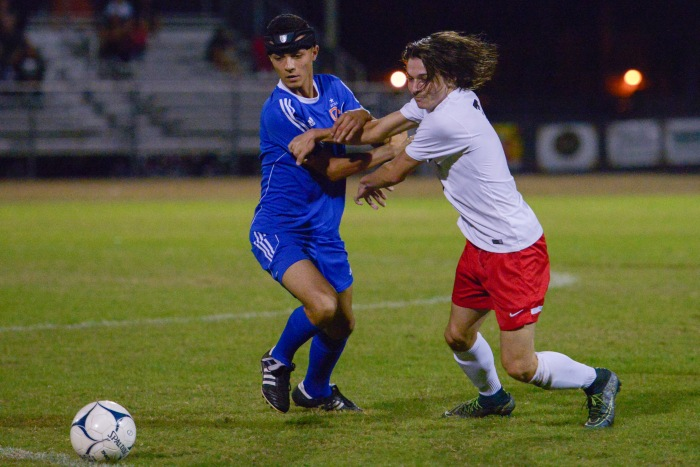 Port Charlotte's Noah Couto fights against Cape Coral's Mateo Castano for possession of the ball (Sun Photo by Jennifer Bruno).