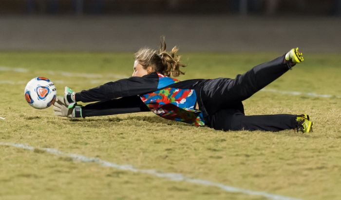 Charlotte's Cheyenne Gaudemer makes a diving save against North Port on Thursday night (Sun Photo by John Kersten).