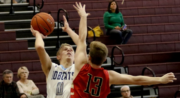 North Port's Zach Babut shoots as Cardinal Mooney's Zack Del Medico defends the first half of Friday's game during the 25th Annual Suncoast Holiday Classic held at Riverview High School in Sarasota (Sun Photo by Michele Haskell).
