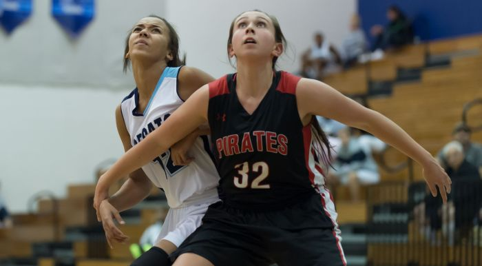 Port Charlotte's Celia Baermann blocks out North Port's Aryana Hough during a free throw attempt on Monday night in North Port (Sun Photo by John Kersten).