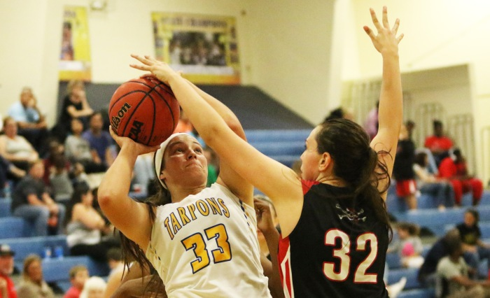 Charlotte's Taylor Kirkus takes a shot as Port Charlotte's Celia Baermann blocks, during Monday night's game at Charlotte (Sun Photo by Michele Haskell).