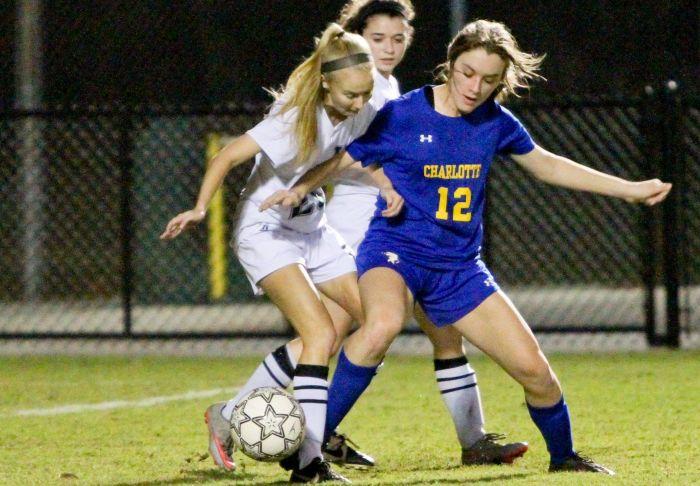 Charlotte's Brooke Lowery fights off a pair of Venice defenders during Thursday night's game at Powell-Davis Stadium. Lowery scored a goal in the Tarpons' 3-2 district loss to Venice (Sun Photo by Justin Fennell)