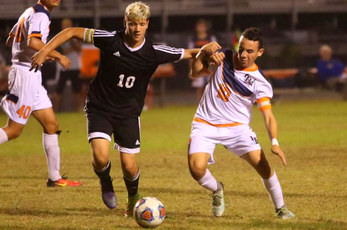 Matias Carbone fights for position as the Lemon Bay Varsity boys soccer team battles Mariner High School on Tuesday night (Sun Photo by Tim Kern).