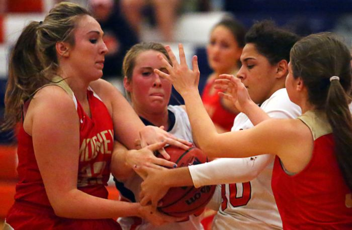 Breanna Nelson and Francesca Gallucci battle two Cardinal Mooney players for possession of the basketball (Sun Photo by Tim Kern).