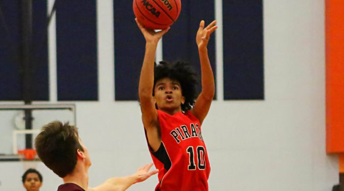 Port Charlotte Alex romero hit a jump shot in the Pirates' game against Tarpons Springs in Thursday's Ryon D. Provencher Shootout at Lemon Bay (Sun Photo by Tim Kern).