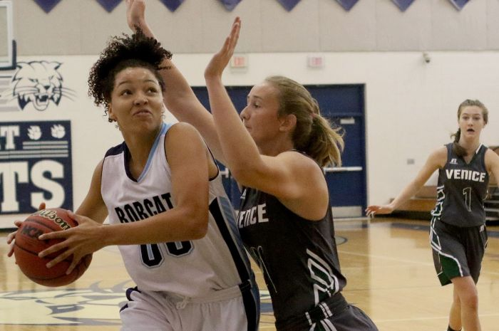 North Port's Alexis Francavilla attempts a shot as Venice's Talee Howard block's during Saturday's game at North Port (Sun Photo by Michele Haskell)