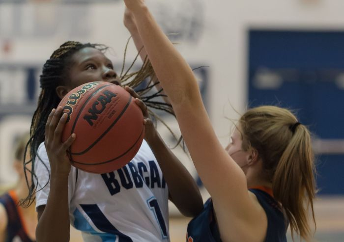 North Port's Emani Jefferson goes up for a shot against Bradenton Christian's Faith Jackson on Friday night in North Port (Sun Photo by John Kersten).
