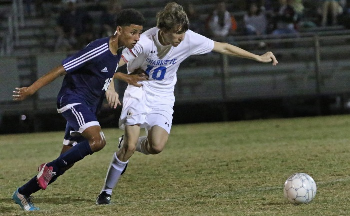 North Port's Anthony Perez, left, and Charlotte's Stephen Young battle for possession during Thursday night's game held at Charlotte (Sun Photo by Michele Haskell).