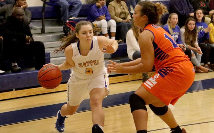 Charlotte's Madison Burton drives to the basket as Cape Coral's Faith White defends, during Friday night's game (Sun Photo by Michele Haskell).