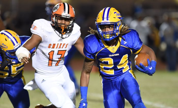 Charlotte's D'Vonte Price runs around for yardage around the end against Miami Carol City's Morris Lugo during the FHSAA Class 6A semifinal on Friday night in Punta Gorda (Sun Photo by John Kersten).