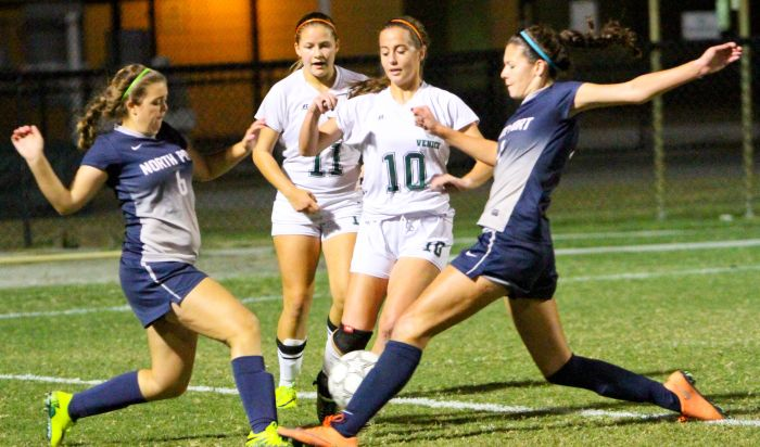 North Port's Lisa Botelho (left) and another Bobcat attacker battle with Venice's Sydney Ayette (10) for control of the ball during Thursday night's game at Powell-Davis Stadium. Sun Photo by Justin Fennell).