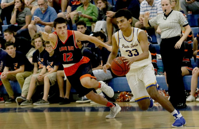 Charlotte's Brandon Lee drives towards the basket as Lemon Bay's Keegan Wyman defends, during Saturday's game at Charlotte (Sun Photo by Michele Haskell).