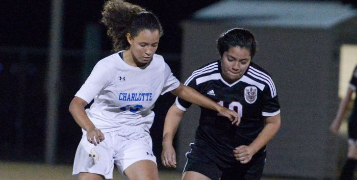 Charlotte's Anacely Zervos dribbles the ball down the field as Palmetto's Estefani Trejo attempts to take possession (Sun Photo by Jennifer Bruno).