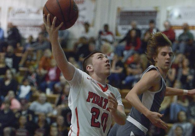 Port Charlotte's Klayton Morris attempts a basket during the Pirates home district game against Lemon Bay (Sun Photo by Jennifer Bruno).