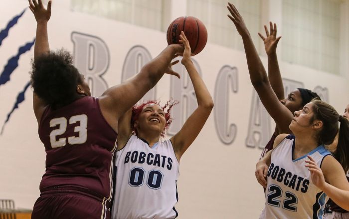 North Port's Alexis Francavilla (00) fights for a rebound with Riverdale's C'dara Manuel (23) during the first quarter Monday at North Port High School (Sun Photo by Tom O'Neill).