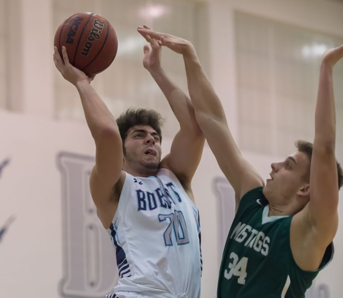 North Port's Adam Cohen goes up for a shot against Lakewood Ranch's Jack Kelly on Wednesday night in North Port (Sun Photo by John Kersten).
