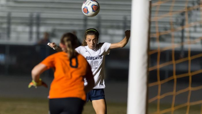 North Port's Alexis Abene scores her second goal on a header beating Braden River's keeper Macienzie Moritz on Wednesday night in North Port (Sun Photo by John Kersten).