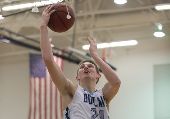 North Port's Bryson Thieme converts a fast break lay up against Charlotte on Friday night in North Port (Sun Photo by John Kersten).