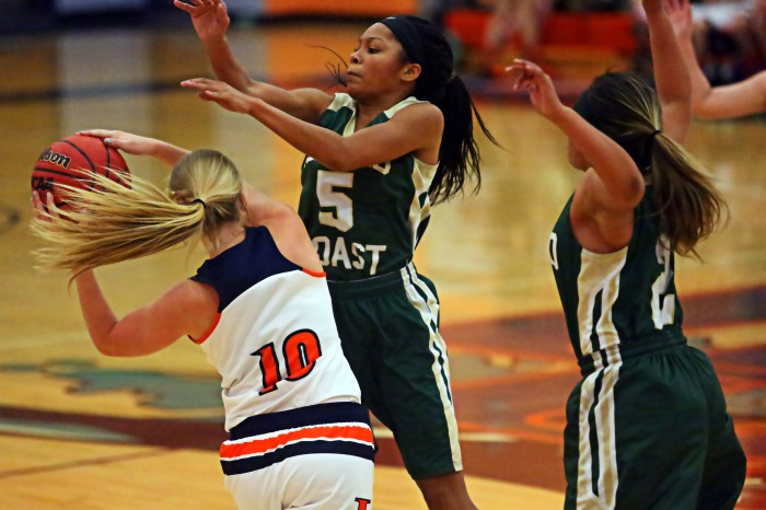 Island Coast's suffocating defense proved too much for the Lady Mantas from start to finish on Tuesday night (Sun Photo by Tim Kern).