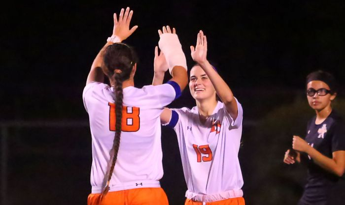 Hope Robson celebrates her goal with teammate Summer Rusher. The Lemon Bay Lady Mantas played host to Sarasota High School on Thursday (Sun Photo by Tim Kern).