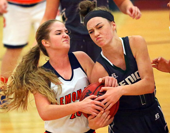 Lauren Maheu gets tangled up and fights for possession of the ball. Maheu's Lemon Bay Lady Mantas were plagued by turnovers against the stifling defense of Venice High School on Monday night (Sun Photo by Tim Kern).
