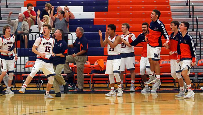 The Lemon Bay bench erupts with joy as Hayden Wolff hits a buzzer beater to end the first half against Ida Baker (Sun Photo by Tim Kern).