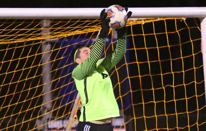 Port Charlotte's Hunter Cole makes a save against Lemon Bay Tuesday night (Sun Photo by Tim Kern).