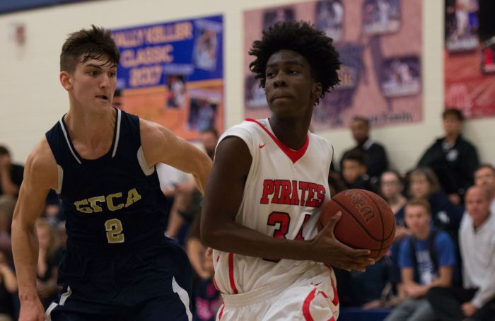 Port Charlotte's Shemar Fleurissant drives to the basket around SFCA's Caleb Catto during Saturday's game at the Wally Keller Classic (Sun Photo by Kat Godina).