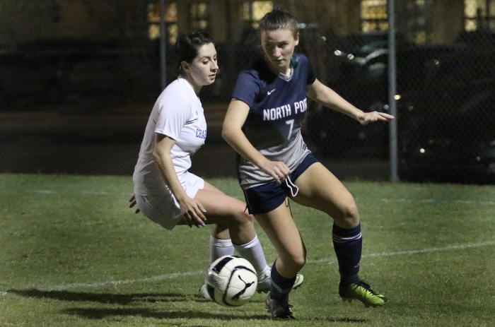 North Port's Seraiah Bailey works the ball to the net as Charlotte's Ashlyn Nims moves to steal, during Thursday night's game at Charlotte (Sun Photo by Michele Haskell).