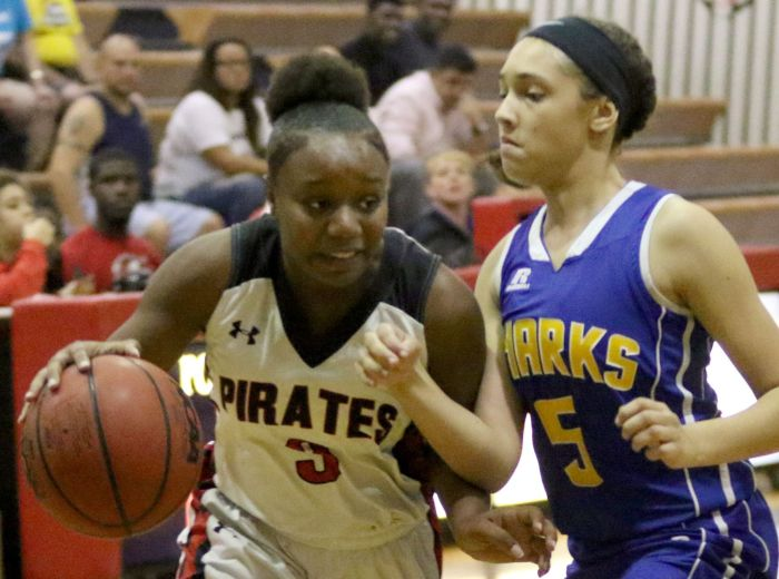 Port Charlotte's Jenae Dennard drives to the basket as Imagine's Arianna Andrade defends, during Friday night's game at Port Charlotte (Sun Photo by Michele Haskell).