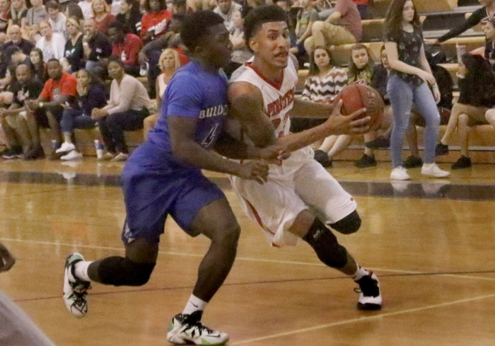 Port Charlotte's Sean Price drives to the basket as Ida Baker's Andy Degurre defends, during Friday night's game at Port Charlotte (Sun Photo by Michele Haskell).