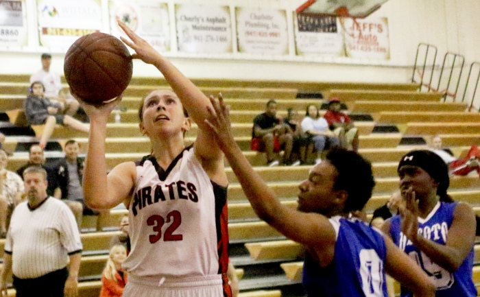 Port Charlotte's Celia Baermann goes up for a shot as DeSoto's Shaterrica Luther blocks, during the 1st quarter of Monday night's game at Port Charlotte (Sun Photo by Michele Haskell).
