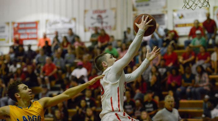 Port Charlotte's Klayton Morris leaps to score two points against Largo on Tuesday evening (Sun Photo by Jennifer Bruno).