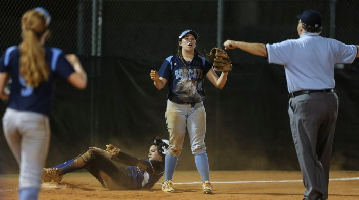 North Port's  Cortney Senna reacts to the umpires signal as DeSoto's D. Johnson (23) is safe at third  base during the seventh inning Monday at North Port High School. DeSoto defeated North Port 5-1 (Sun Photo by Tom O'Neill).