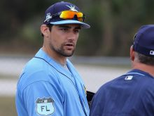 Tampa Bay Rays pitcher Nathan Eovaldi talks with manager Kevin Cash Tuesday at Charlotte Sports Park. Eovaldi is rehabbing from Tommy John surgery.  Photo by Tom O'Neill