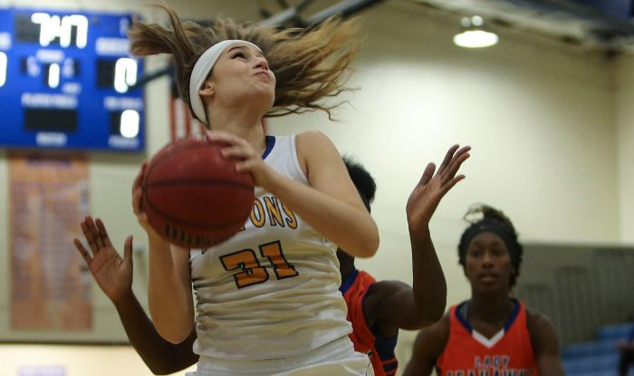 Charlotte Tarpon Michelle Bunch (31) looks to shoot against Cape Coral during the first period Friday at Charlotte High School (Sun Photo by Tom O'Neill).