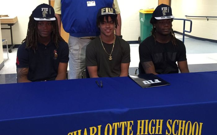 D'Vonte Price, Jacobs White and G'Vonte Price all signed their letters of intent to play football at FIU next year (Sun Photo by Bryan Levine).