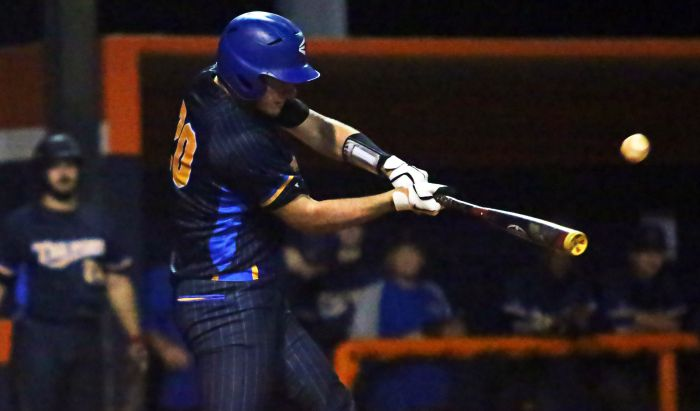 Aaron Martins hits a home run for Charlotte High School Friday night against Lemon Bay (Sun Photo by Tim Kern).