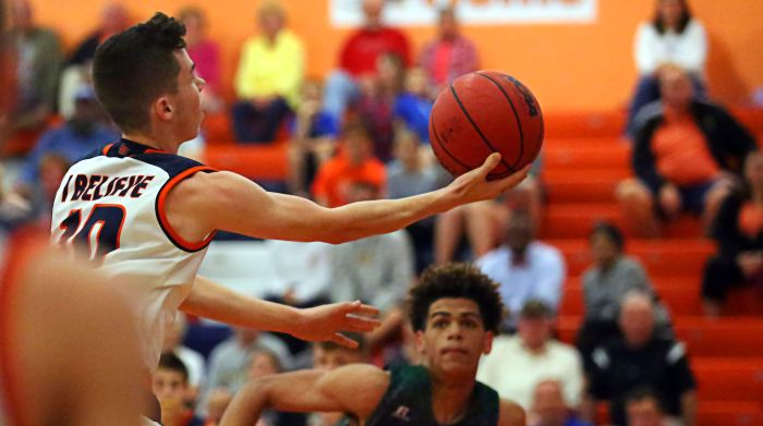 Lemon Bay's Cade Huber with a layup attempt in Thursday's loss against Venice (Sun Photo by Tim Kern).
