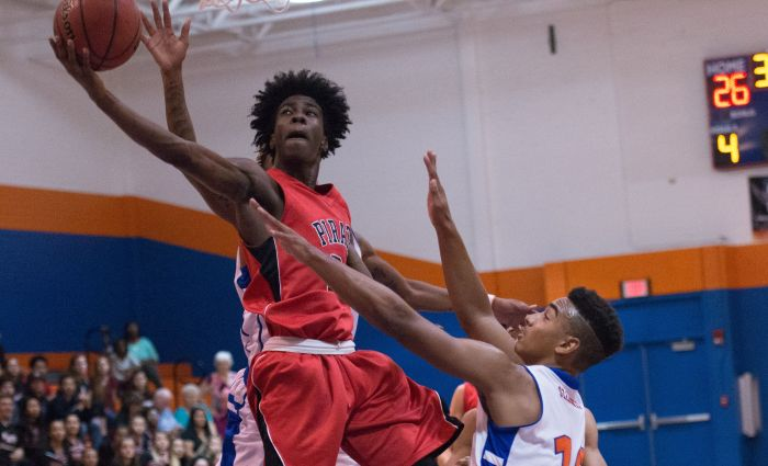Port Charlotte's Shemar Fleurissant goes to the hoop over Cape Coral's James Gibson during Wednesday's game (Sun Photo by Kat Godina).