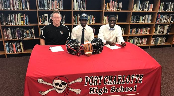 "Port Charlotte football players Stephen Nagy (left to right), Tiyan ""Pop"" Bush and D'Andre Lewis all signed letters of intent to play college football Wednesday morning. Nagy is headed to Sterling College, Bush to the University of New Hampshire and Lewis to Mars Hill University (Sun Photo by Jordan Kroeger)."