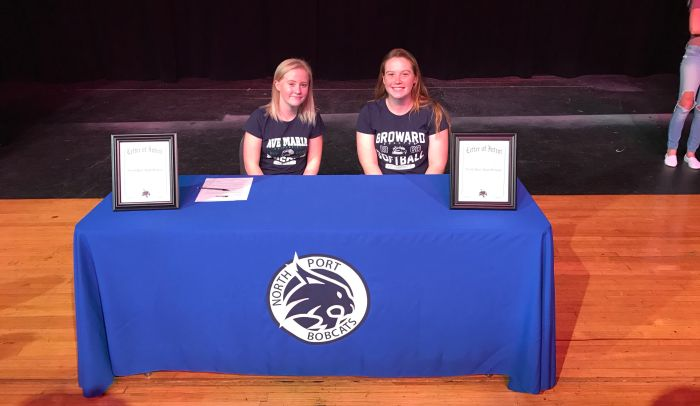 North Port soccer player Alexis Howarth (left) and softball player Skylar Poitras signed letters of intent Wednesday morning. Howarth will play college ball at Ave Maria University while Poitras will catch at Broward College (Sun Photo by Jordan Kroeger).