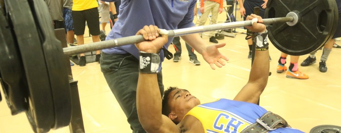 Charlotte's Shek Ayemperoumal works to bench 290-pounds during Monday's match at Charlotte.