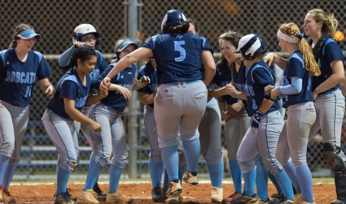 North Port's Brianna Mitchell is mobbed by her teammates at homeplate after her homerun in the bottom of the 8th inning on Thursday in North Port.