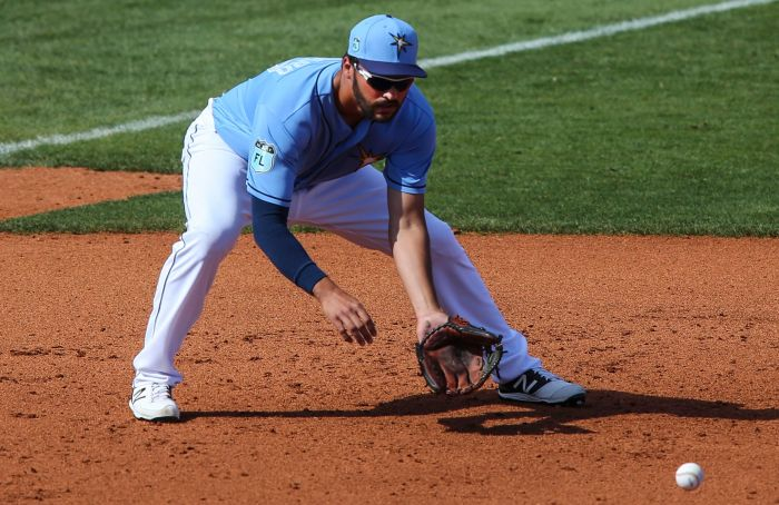 Tampa Bay Rays third baseman Patrick Leonard (67) fields a ground ball between innings against  Baltimore Saturday at Charlotte Sports Park (Sun Photo by Tom O'Neill).